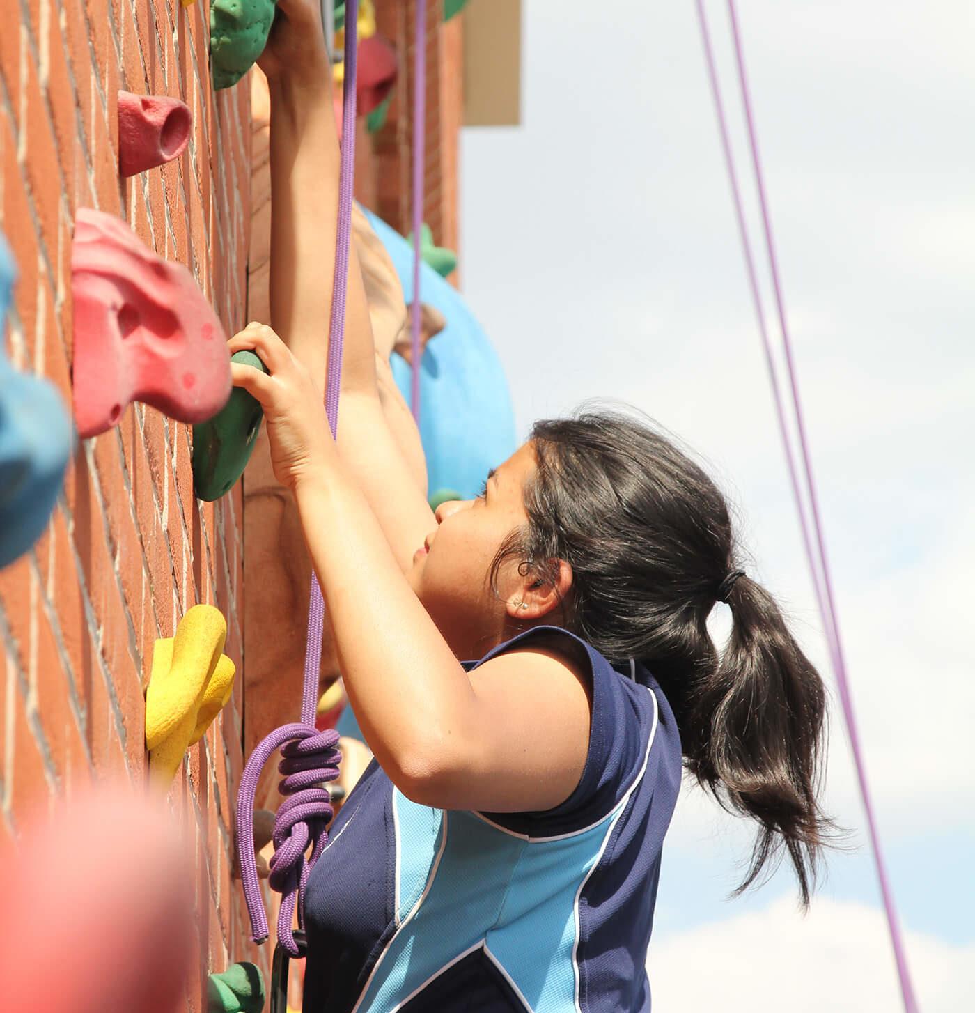 girl using the nottingham girls' high school climbing wall