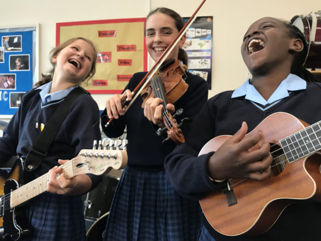 nottingham girls' high school students playing instruments