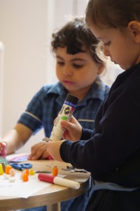 nursery pupils concentrating on making things