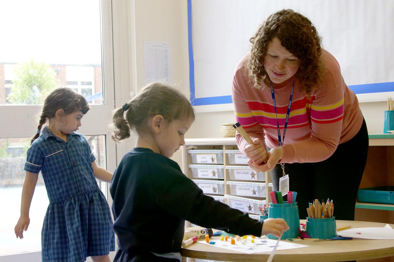 nottingham girls' high school teacher interacting with a pupil