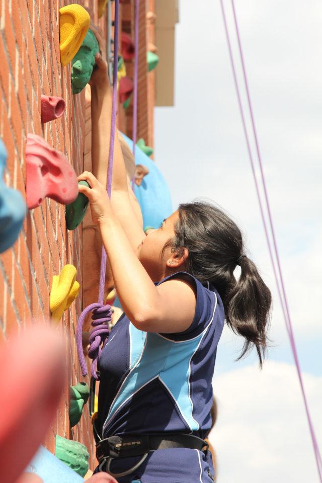 nottingham girls high school student climbing on climbing wall