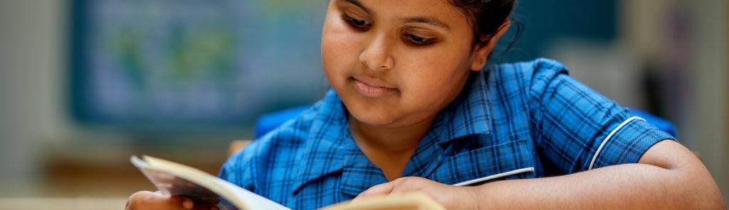 nottingham girls' high school pupil reading a book