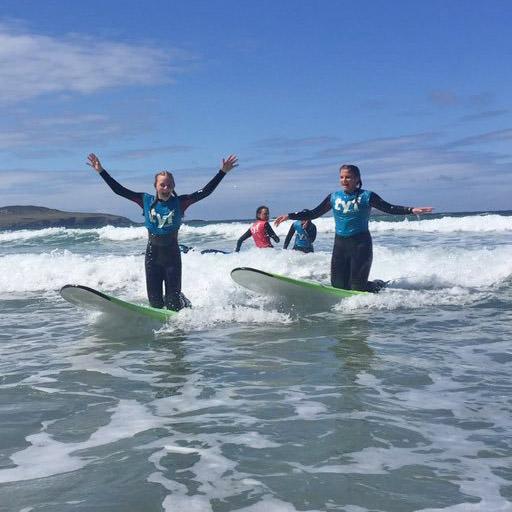 school students surfing