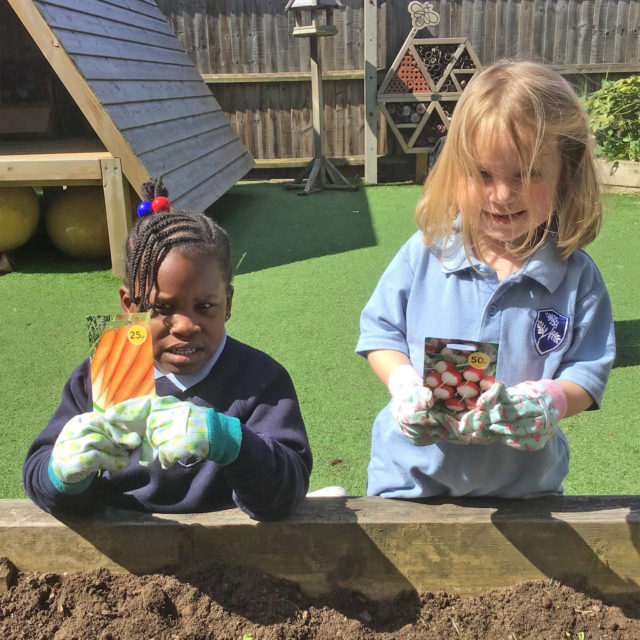 girls using nursery garden facility at school